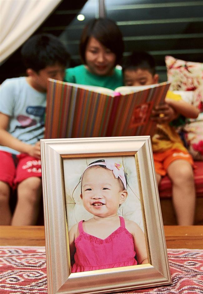 Esther Lim was barely three when she died of an undetected brain tumour, leaving behind her parents and two brothers.