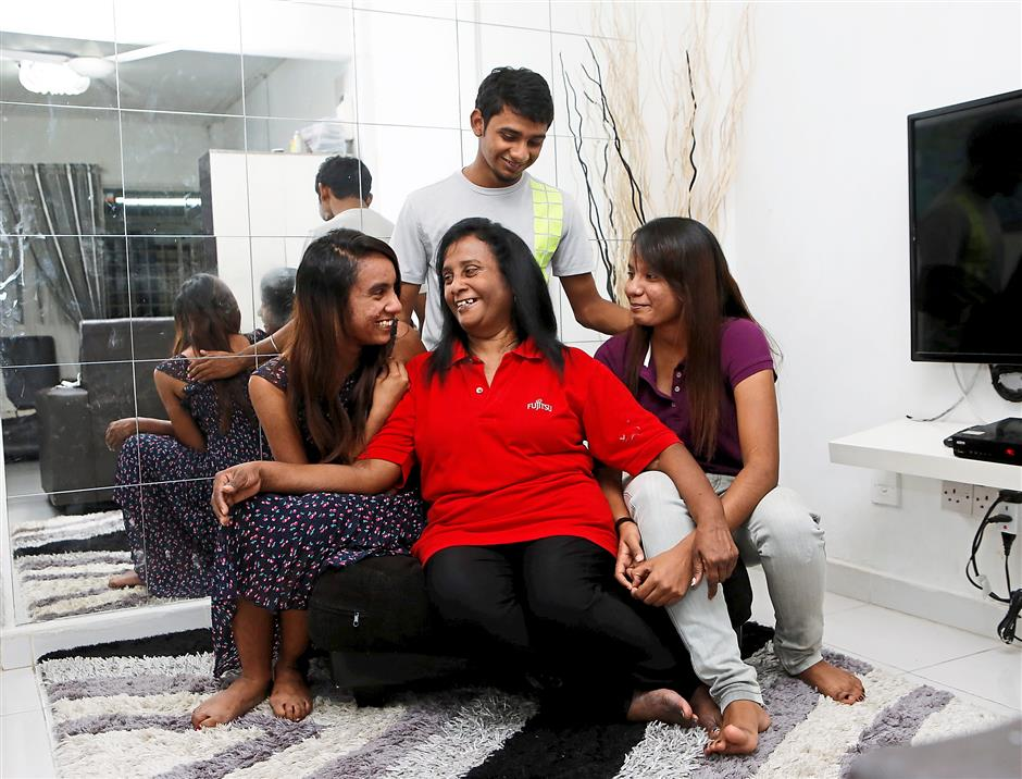 Life goes on:Jothy and her children have built a happy life for themselves. Photo: The Star/Azhar Mahfof